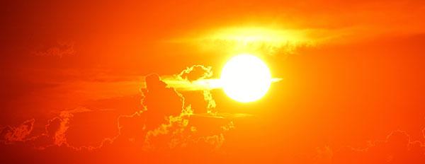 عکس غروب خورشید در ابرهای آسمان