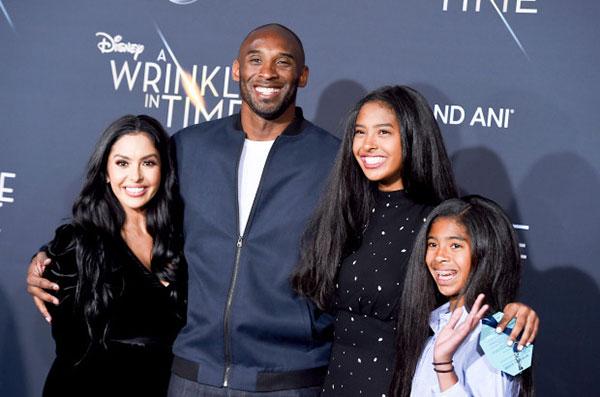کوبی برایانت و همسر و دخترانش